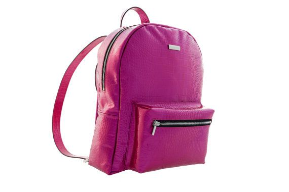 Make a statement in your off-duty repertoire with this fuchsia backpack from MONAO. Crafted with Croc pattern embossed patent leather catches all