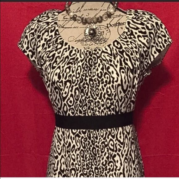 Elie Tahari for Nemian Marcus Leopard Dress Sz. 6 I am selling this gorgeous Elie Tahari Black and white leopard print dress. The dress is exclusively for nemain marcus and is made of 96% Silk and 4% Elastane. The dress is a Sheath dress and Is New Without Tags and is a size 6! Elie Tahari Dresses