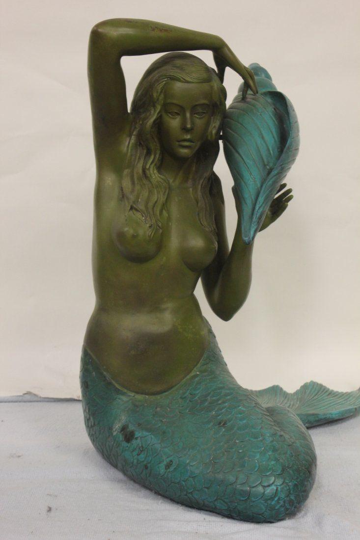 Large bronze sculpture of mermaid
