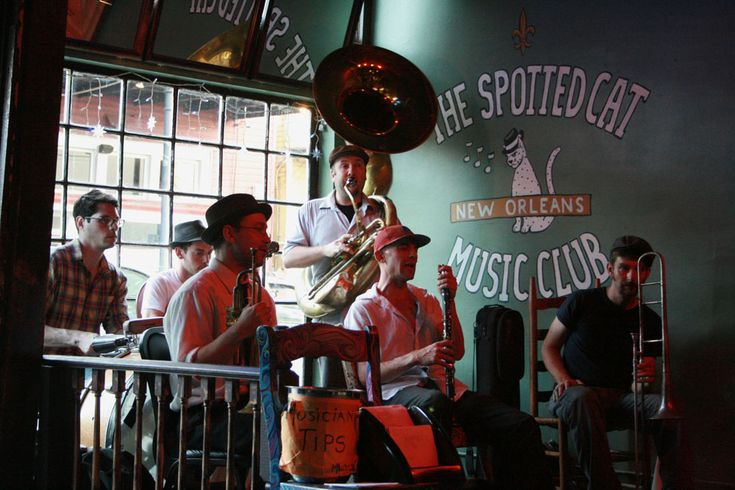 The Spotted Cat: This live music venue features authentic jazz and blues bands from open to close. Located at 623 Frenchmen Street, open nightly.