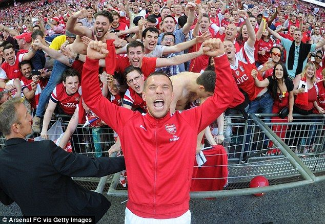 Leading the celebration: Podolski celebrates with the Arsenal fans after the FA Cup final win