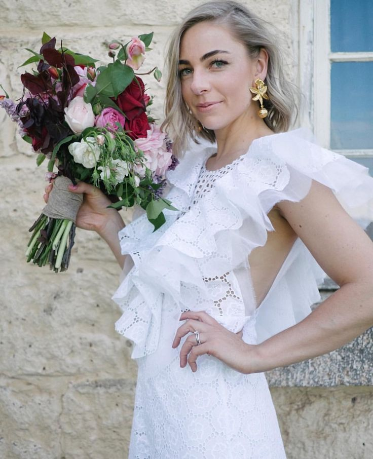 Claire is wearing 'we're hungry for' dress in cotton broderie anglaise #nevenka #madeinmelbourne #australiandesigner #wedding #bride #whitelace #lace #dress