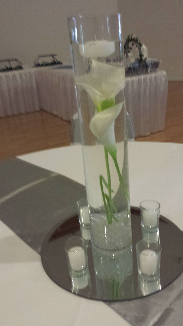 Tall Cylinder White Calla Lily Submersed In Water With Floating Candle Wedding Centerpiece