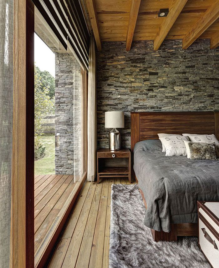 Stone House with Magnificent View by Elias Rizo Arquitectos wonderful wooden parquet bedroom. Rustic vibes in a contemporary interpretation. Great interplay between indoor and outdoor spaces.