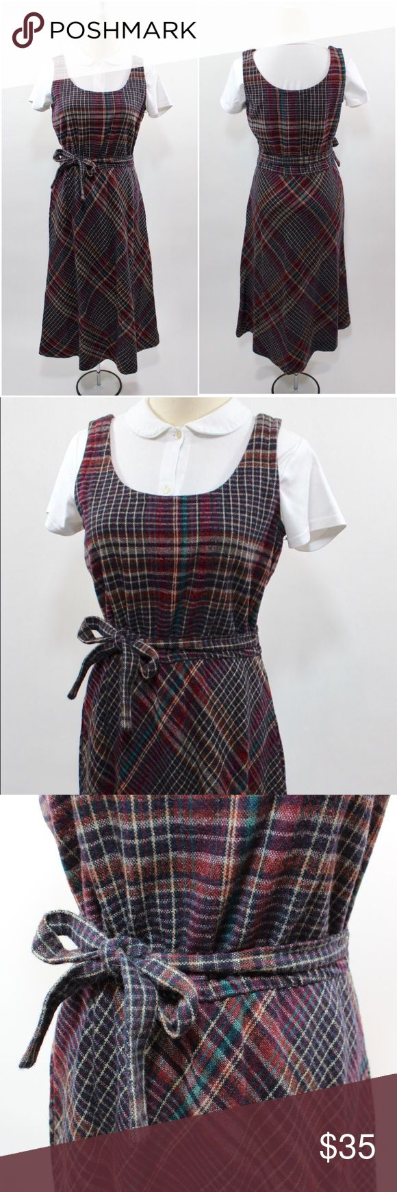 "1970's Wool Tartan Plaid Jumper Dress A women's vintage 1970's gray and burgundy red tartan plaid wool jumper dress with an elastic waist and tie belt to cinch. This dress also has pockets.  -+- Condition -+- Excellent vintage condition with no flaws   -+- Measurements -+- (already doubled where necessary) Bust, from pit to pit - 36"" Waist - 31""-34"", but can be made smaller with the tie belt. Hips -  42"" Length - 45"" Material/Tag - Act I - Wool - Vintage size 9/10 Vintage Dresses Midi"