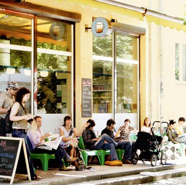 """Galão A Pastelaria ~ Oodles of people swamp this coffee shop in Mitte during the warm season — ostensibly not for its Portuguese pastry, fresh sandwiches, soups, espressos or Galãos (Portuguese for """"latte"""") — but for its scene. Couched at the bottom of the Kastanienallee hill and opposite of Weinbergsweg park, the cafe offers hunter green lawn chairs and concrete steps and welcomes four-hour Sunday afternoon conversations and people-gawking. #Berlin #Galao #Pastelaria #Weinbergsweg"""