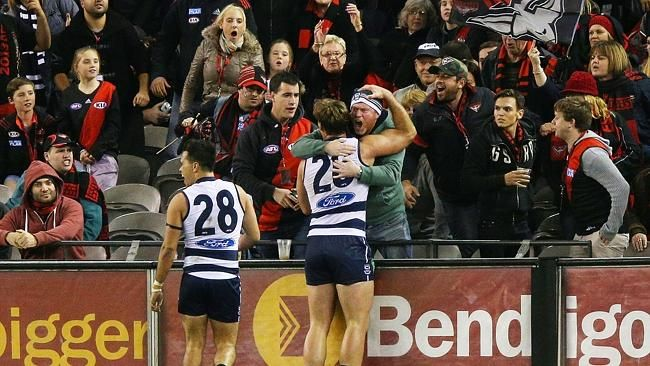 Tom Hawkins finds the one Geelong supporter in a sea of Bombers fans after kicking the goal that sealed the Cats victory against Eseendon, June 2014.