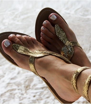 This stunning leather sandal is a 2012 must have, comfortable as well as stylish. Add some glamour to sunshine days, and team up with one of our maxi dresses for the ultimate in Grecian glam! The Cobra leather sandal has a snake skin look leather strap which wraps lightly round your ankle - the strap is lightly wired which ensures it stays in place so no fastening is required. On a natural coloured full leather...