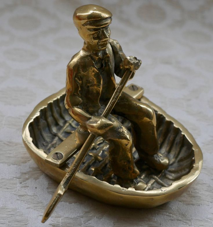 Brass Ornament, Man In Coracle, Vintage Brass Decor, Brass Figurine, Rowing Boat, Brass Decor, Welsh Gifts, Gift For Him, Welsh Decor by RetroEtCetero on Etsy https://www.etsy.com/listing/525996566/brass-ornament-man-in-coracle-vintage