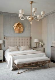 gold art over bed gray and tan neutral bedroom