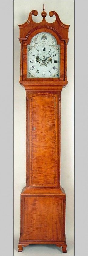 An unsigned tiger maple tall case clock, circa 1805.  Nice!