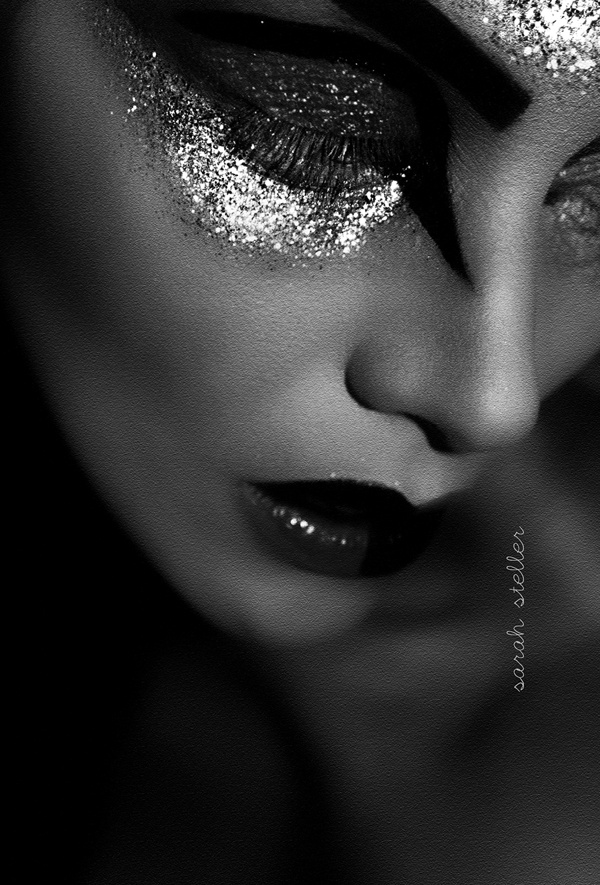 Dramatic severe glamorous glitter intense eye makeup black and white photography