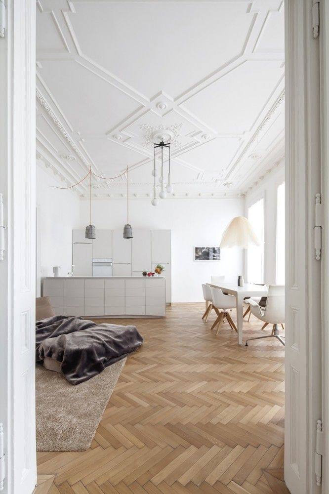 beautiful open space + tall amazing ceilings + herringbone wood floors. love everything about this room.