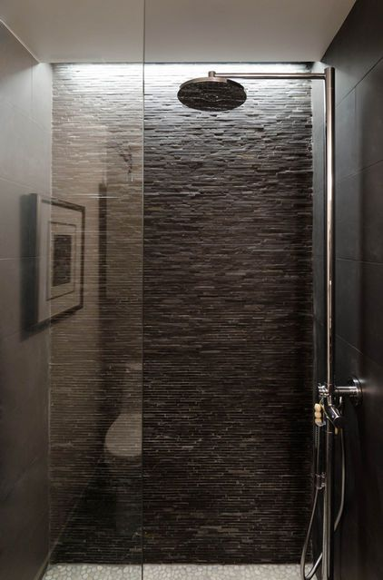 I SO love this shower!!   A recessed light was used to create the illusion of a skylight. And that slate wall!!! There are few things I love more than stone accent walls. Too beautiful.    Tile: Stone Black Slate Mini Sticks