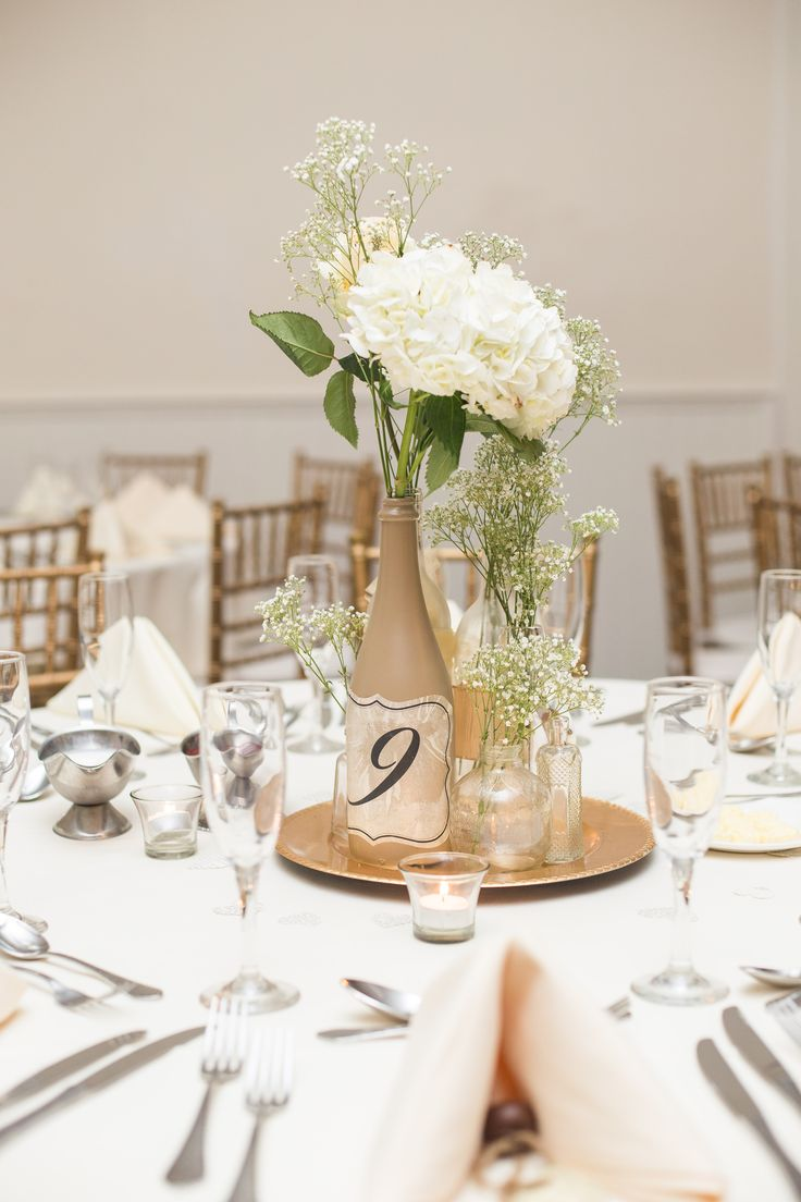 Diy wine bottle centerpiece with hydrangeas and blush for Table arrangements