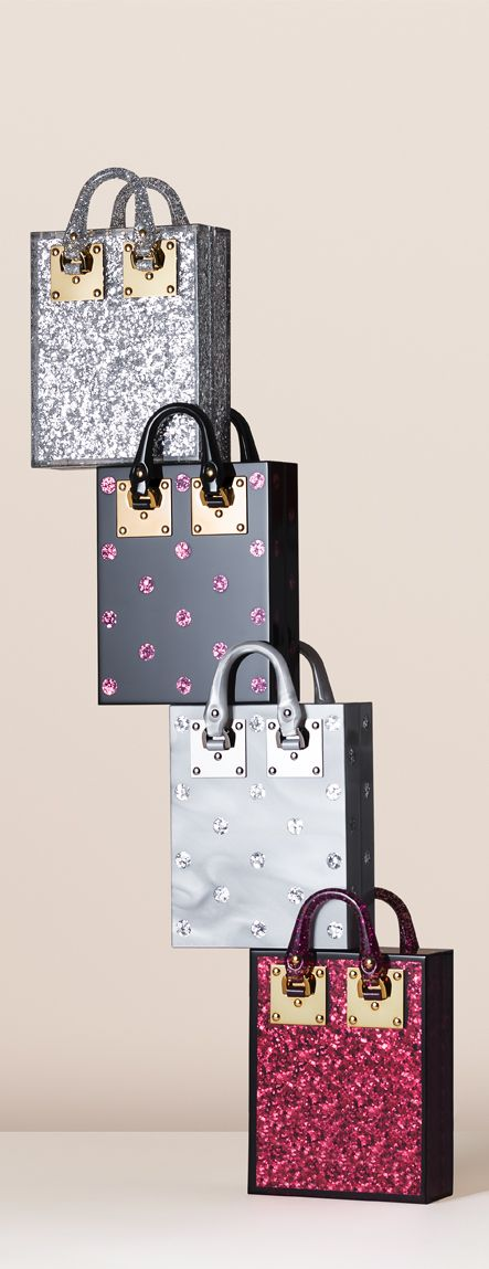 Compton Evening Wear Totes stacked up. These miniaturised versions of the popular Albion tote are crafted in polished plexiglass. Inlaid glitter and marble effects make them the perfect addition to a party look - or wear by day to elevate understated styles.