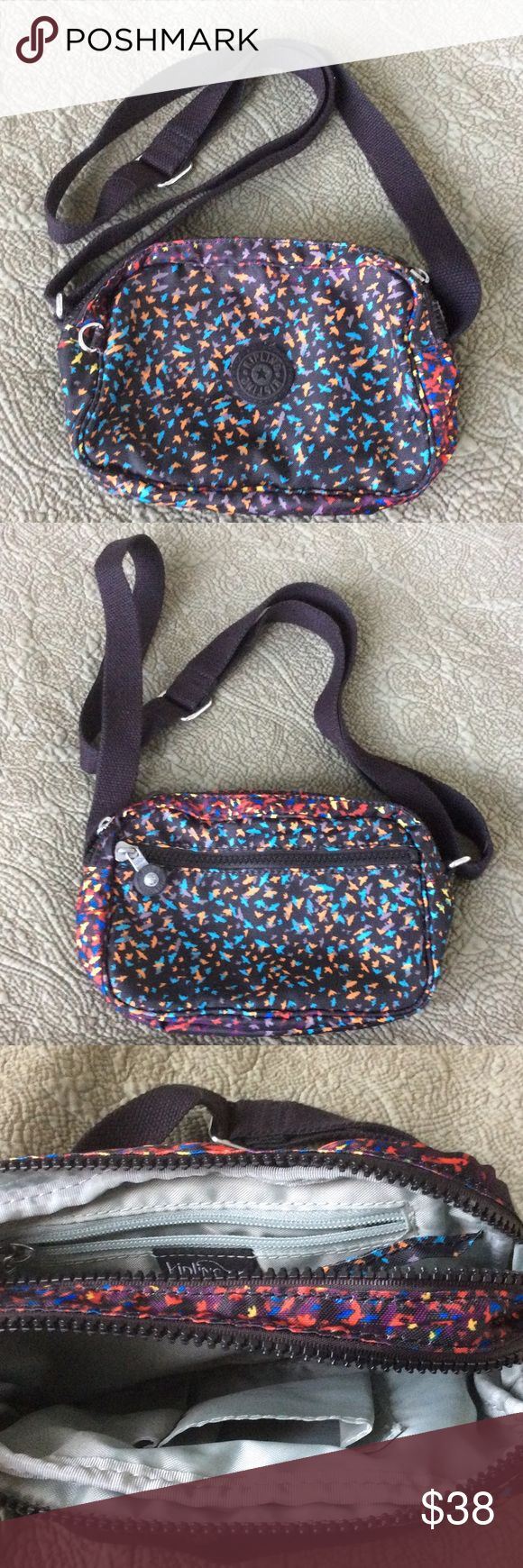 """EUC Kipling cross body bag Price firm.   Measures about 8"""" x 5"""" x 3"""" 2 zipped compartments in center, and one outside Adjustable strap Red, yellow, orange, blue, and purple birds on a black background Kipling Bags Crossbody Bags"""