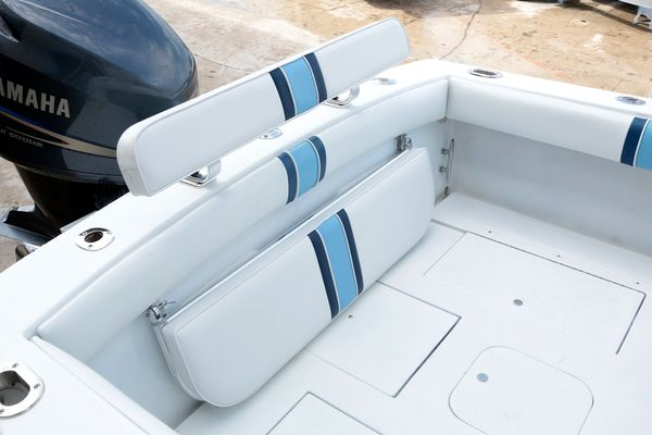 Here are six ways to add seating aboard any sport-fishing boat. Birdsall's stern bench seat folded away to make more fishing room