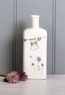 Large flat backed bottle based on a medicine bottle shape perfect for the wistful meadow illustration.