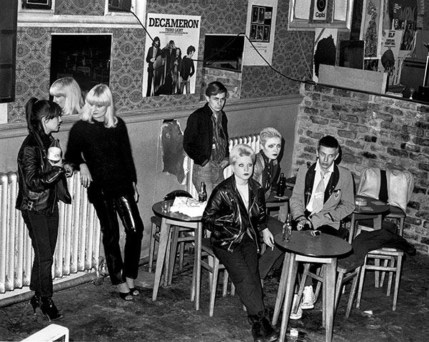 The Bromley Contingent, Acme Attractions shop, November 1976 (at the table, left to right, Debbie Juvenile, Siouxsie Sioux and Steven Severin; behind them, Simon Barker)