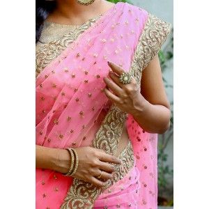 Beautiful pink saree with golden bootie handwork and embroideried border