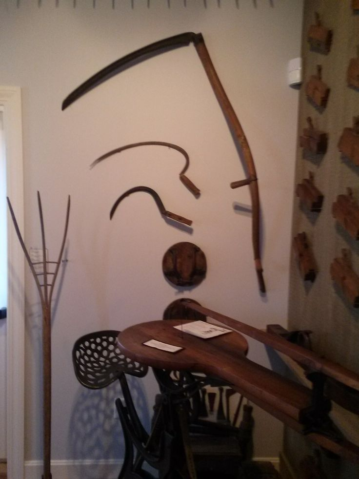 Photo taken in 2014:  On the wall shows items that were used in collecting Marsh Hay: Scythe, Sickle, Marsh Horseshoes and a Hay Fork. On the floor a scroll saw. Currently reside in the Tool Room at Atwood House Museum, Chatham, MA. #atwoodhouse, #chathamhistoricalsociety, #chatham, #capecod, #toolroom, #scrollsaw, #scythe, #sickle, #horseshoes, #hayfork