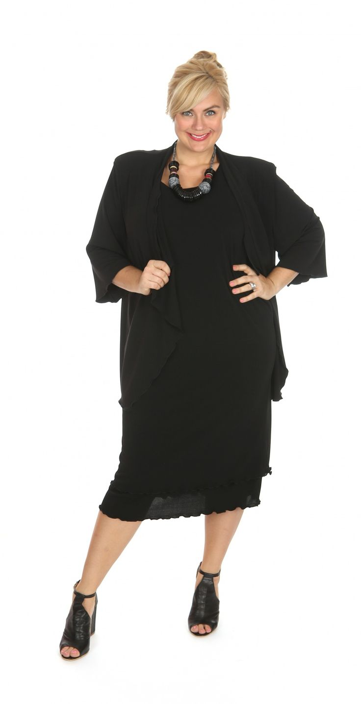 Classic black waterfall jacket in poly spandex knit: Our classic waterfall jacket in a poly spandex knit. Pictured here in black with matching layer dress. Fabric: Polyester Spandex Label: Lagos