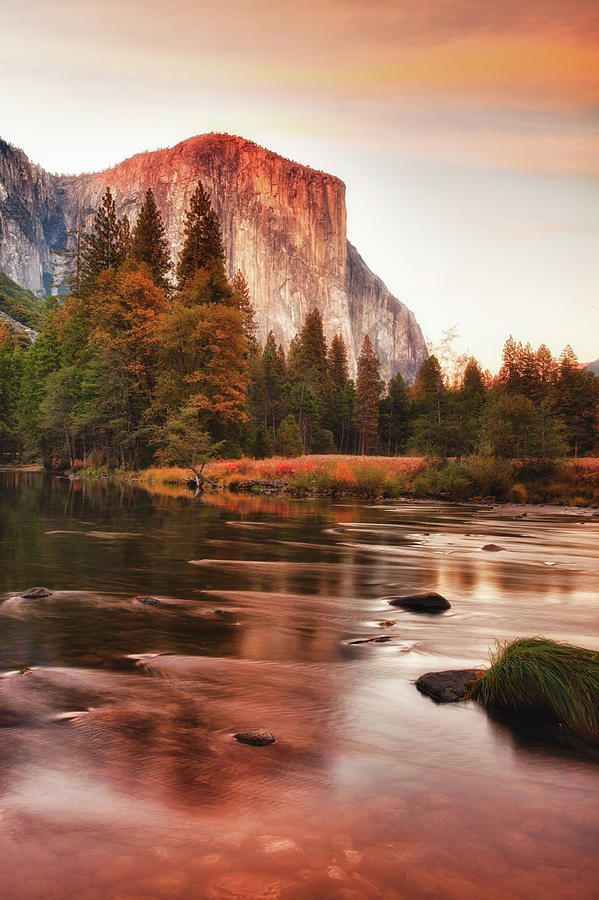 Lake and Sunset as it lights up face of El Capitan in Yosemite National Park