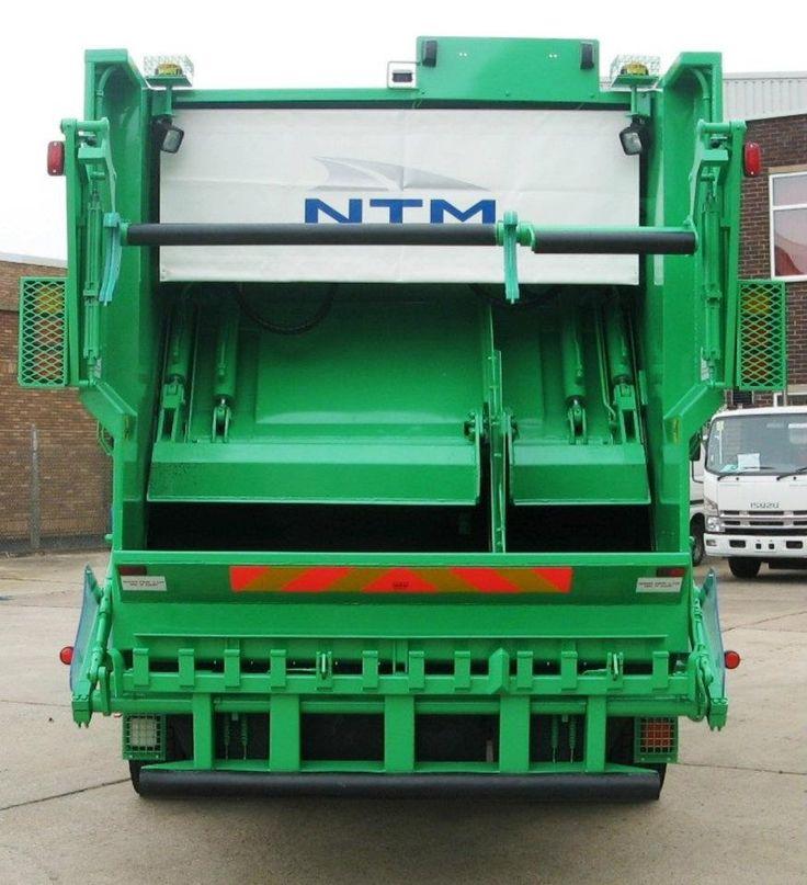 Płyty prasujące w śmieciarce NTM K-2K. Śmieciarki dwukomorowe to ekonomiczne rozwiązania dla zbiórki dwóch odpadów jednym kursem. Refuse truck, rear loader, garbage vehicles, Kommunalfahrzeuge, Benne a ordures, Recolectores, camion, Carico posteriore
