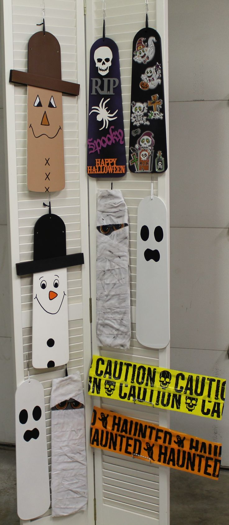 Repurposed ceiling fan blades made into holiday décor. Mummies, ghosts, and reversible scarecrow/snowman décor.