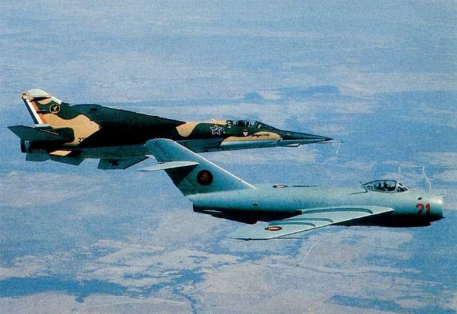 A 1 Sqn Mirage F1AZ and a Mozambique AF Mig 17 in flight. This was the Mig 17 with which Lt Bomba defected from Mozambique