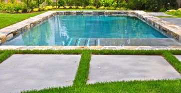 Large concrete pavers - consider just making pads for lounge chairs in front of pool...