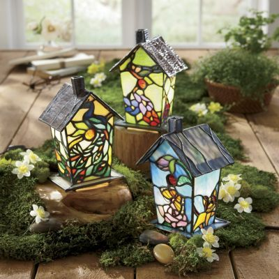 "Stained Glass Birdhouse Lamp Save 19% $79.95 $63.99 Read Review (0) | Write a review These brilliant birdhouses give you something to chirp about, with intricate, stained glass designs that turn a lamp into a piece of art. 7-watt max. candelabra bulb (not included). Metal frame; open bottom to access bulb. 4 3/4"" w x 7 1/2"" h x 4 1/4"" d."