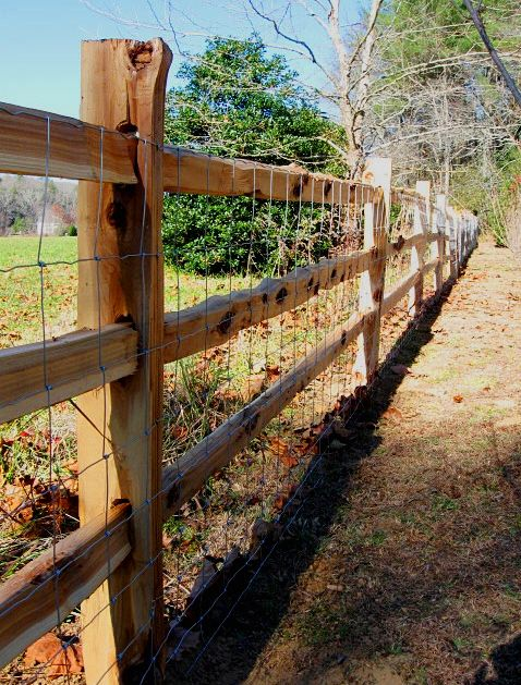 post and rail fence with hog wire attached