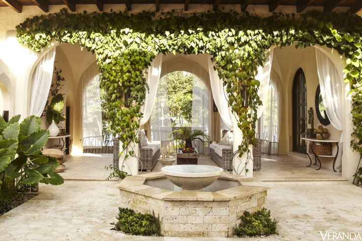 Ivy Covered Arches Are A Timeless Note At The Entrance To A Loggia In