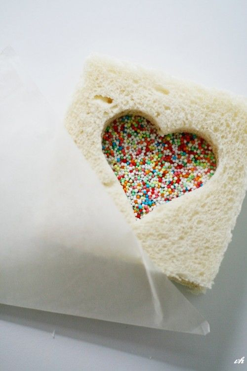 Two slices of bread. Spread peanut butter on one. Use cookie cutter of choice on the other. Sandwich the two and sprinkles of your choice. ummm Thinking maybe jelly instead of sprinkles.
