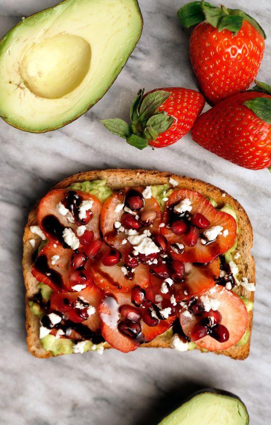 Sweet avocado toast: Avocado, Pomegranate Seeds, Strawberries, Feta, & Balsamic