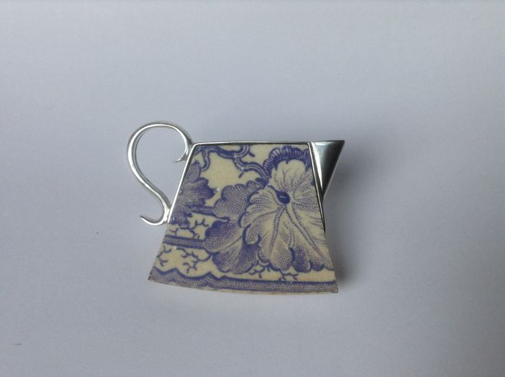 Ceramic jug brooch by Maggie Laing