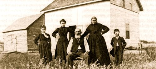 """Brenda Purcell: """"My great great grandmother, Marguerite Dumas second from right in front of her house in Batoche. She famously told Louis Riel that if he did not send reinforcements and ammunition to the Métis men fighting at the Battle of Tourond's Coulee, she would go herself. According to witnesses Riel said to her, """"Don't get angry without reason, Gigitte."""" Her answer? """"I am not angry without reason."""" Of course this scene is in my book."""""""