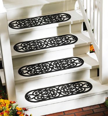 Scrollwork Rubber Safety Step Mats would look even better on steps with an iron railing.