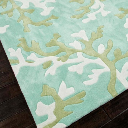 Hand-tufted rug with a coral reef motif.    Product: RugConstruction Material: PolyesterColor: Blue an...