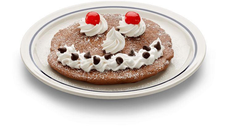 Start the day smiling! The Funny Face breakfast @IHOP is a chocolate chocolate chip pancake with whipped topping. #IHOP