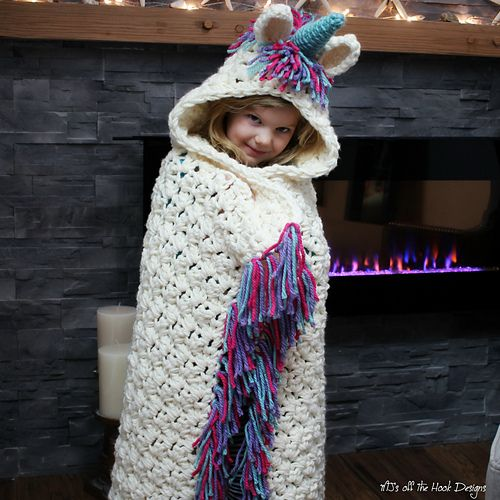 This is a PDF crochet Grammy I know a little girl who would LOve this! pattern for a Bulky & Quick Unicorn Blanket! Pattern also includes a Hooded Unicorn Cowl in toddler-adult size.