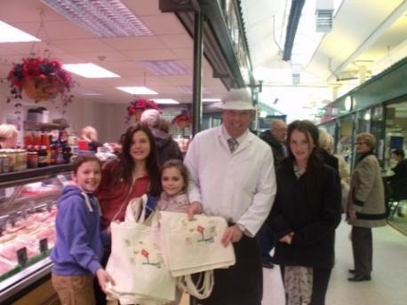 """Owen Booth, Taylor Reynolds, Samantha Ireland and Kiera Wright who took part in an enterprise """"apprentice """" event at Widnes Market. PIctured with  butcher Clive Middlehurst"""