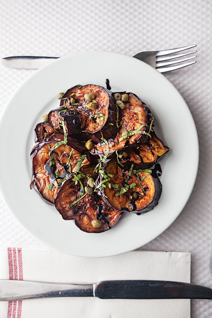 From SAVEUR Issue #163Sweet, mild eggplant pairs with briny capers, floral basil, and a drizzle of balsamic reduction in this recipe inspired by a dish served at Le Bistrot d'Edouard.