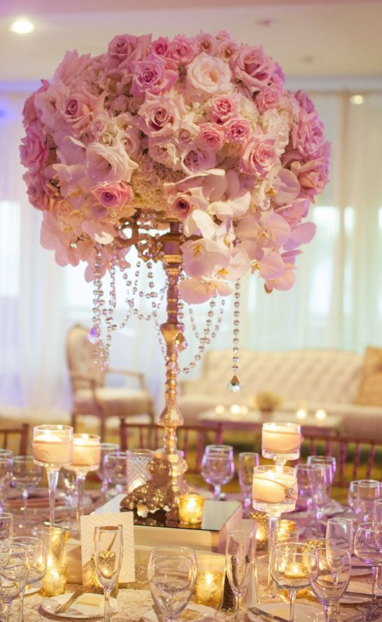 Photographer: She Wanders Photography, Via Blush Botanicals; Stunning pink rose and white orchid gold wedding reception centerpiece;