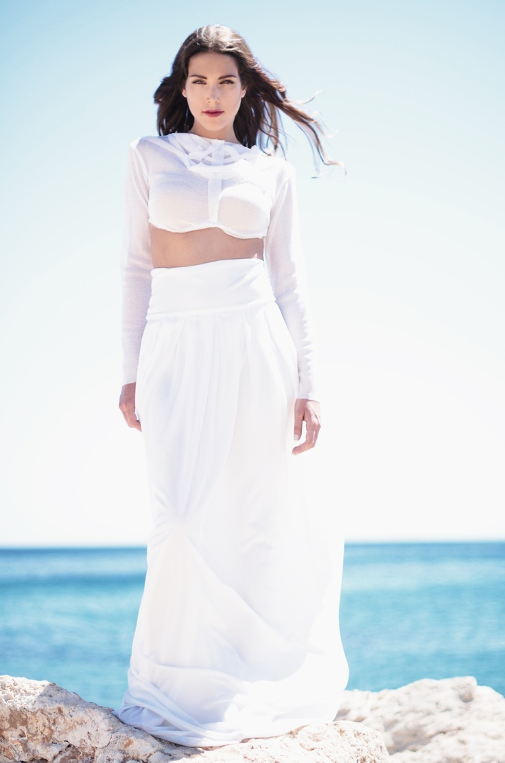 actress Eugenia Tsaousi in Christina Skarpeli total white outfit of new collection