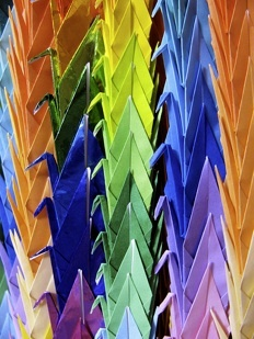 Japanese Senbazuru is a string of 1000 paper cranes. It is usually sent to a person who is ill or injured as a prayer for recovery, or for good luck.