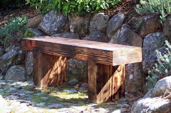 """This simple garden bench is constructed from recycled douglas fir beams. Most of the material comes from local home remodels. The Zen Bench is uniquely finished - with a blow torch char, then clear sealed with a marine-grade varnish.    Sizes Available:    Large - approx. 48""""L x 14""""T x 10""""D  (size varies based on lumber found)"""