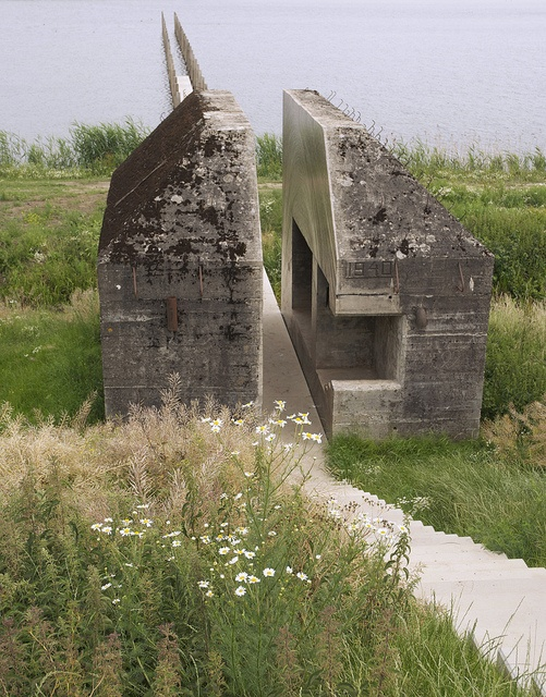 Bunker 599 of the New Dutch Waterline (NDW) in the Netherlands; sliced open by artist Erick de Lyon and Rietveld Landscape Architects.  The NDW was a military line of defense made up of dikes and forts and fortified towns, and in use from 1815 until 1940 (photo by Bart van Damme, via Flickr)